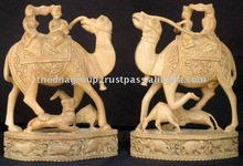 carved statues/wooden camel statue