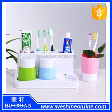 Bathroom plastic toothbrush and toothpaste holder/frame