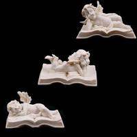 Lying on Book resin Cherubs/ small cherub figurine