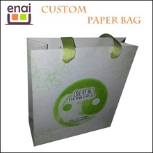 Shopping luxury bag brown craft paper bag with green handles and Watermark