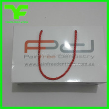 Customized size ribbon/ pp rope high quality fancy paper gift bag