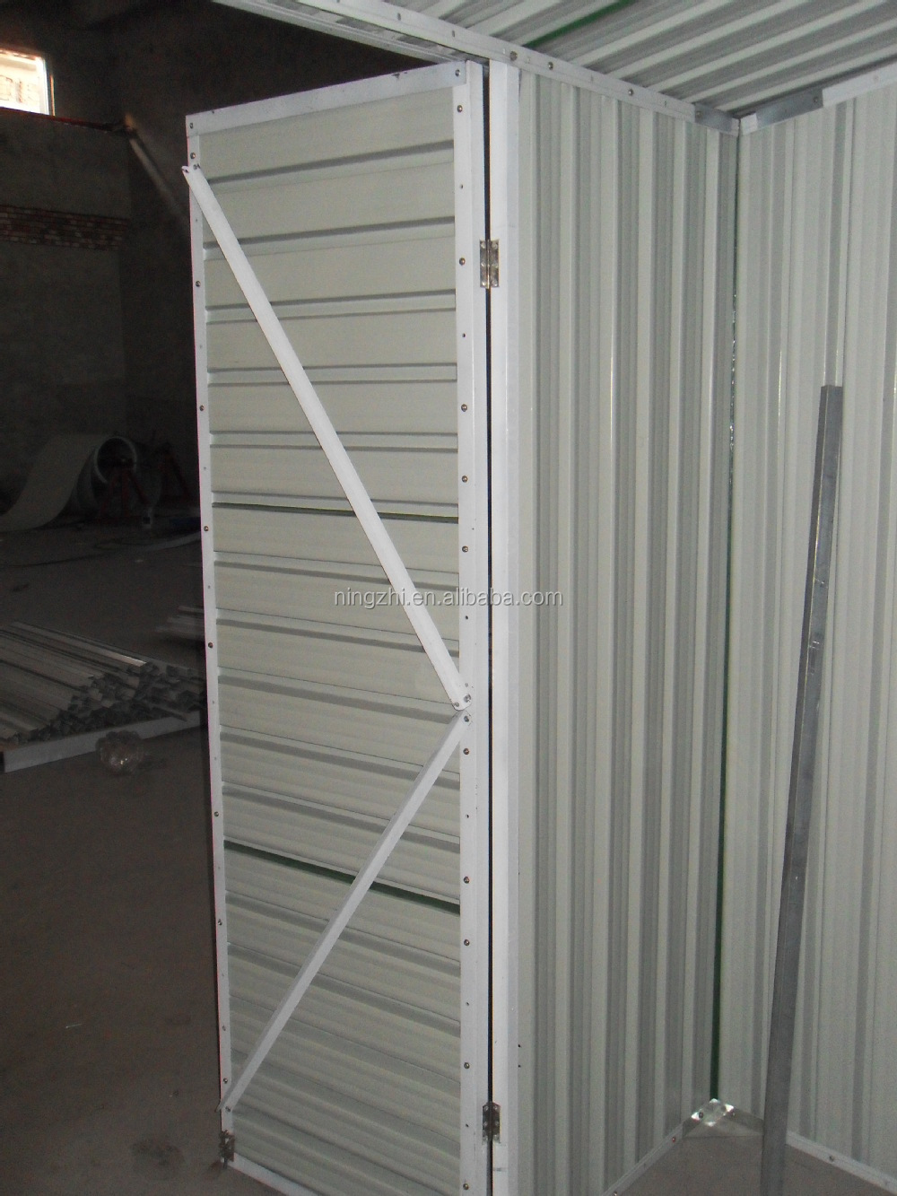 Large size shed with roller door green metal garden shed for Garden shed with roller door
