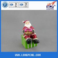 Handmade polyresin santa claus figurine,christmas santa carrying gifts,gift box