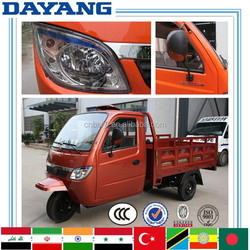 Africa gasoline motorized closed cabin high quality low cost motor tricycle for cargo