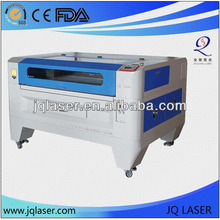 china,JQ CO2 cnc acrylic,wood,leather,balsa,pvc,stencil,fabric,eva Laser cutter eastern price
