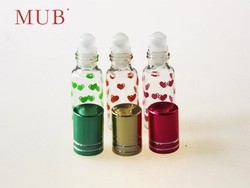 Empty 6ml clear plastic roll on deodoration glass bottle for cosmetic perfume with metal cap and printed heart pattern