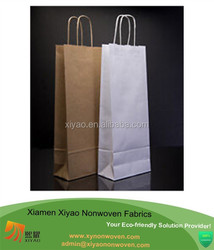 brown and white paper wine bag