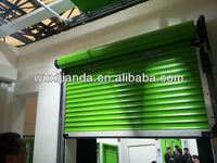 china high insulated double galvanized steel rolling door with polyurethane