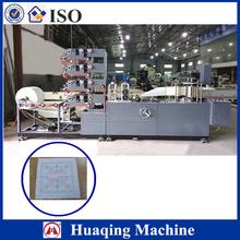 Paper folding and printing napkin machine