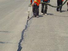 How to fill cracks in concrete bridge
