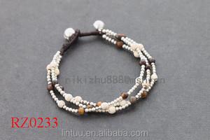 China Atacado Moda talão olho de tigre e branco pérola pedra edforce jóias em aço inoxidável Pulseira