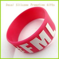 Watermelon red enbossed printing with white in the silicne wristband