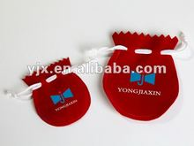 small red jewelry pouc with white drewatring