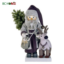 exquisitely crafted santa claus wooden Nutcracker with reindeer