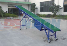 Simple rubber belt loading/unloading conveyor with stainless steel frame is to continuously convey articles ia tilted way with b
