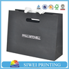 Luxury matte black paper bags with diecut handle for hair products packaging