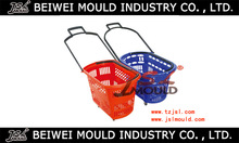 Injection mould for plastic shopping basket with wheels