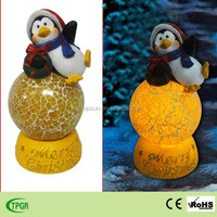 Christmas decoration polyresin penquin with glass ball led solar light for X'mas ornament