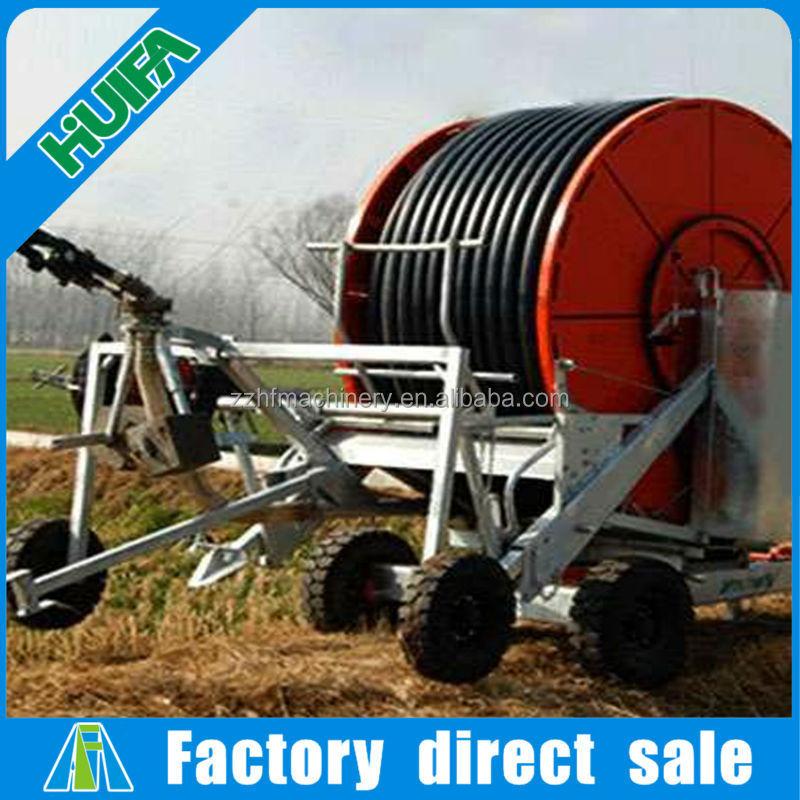 Automatic farm hose reel irrigation system with spray gun