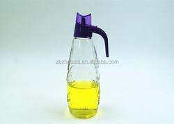 Glass embossed oil vinegar cruet dispenser with plastic pourer and hanle