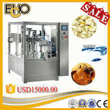 2015new grade ultra smart professional rotary pre pouch Carousel type counting full automatic Cashew nuts filling machinery