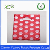 Printed red color and white dot die cut handle plastic bags