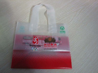 HDPE T-shirt packaging bag on roll with small recycling symbol