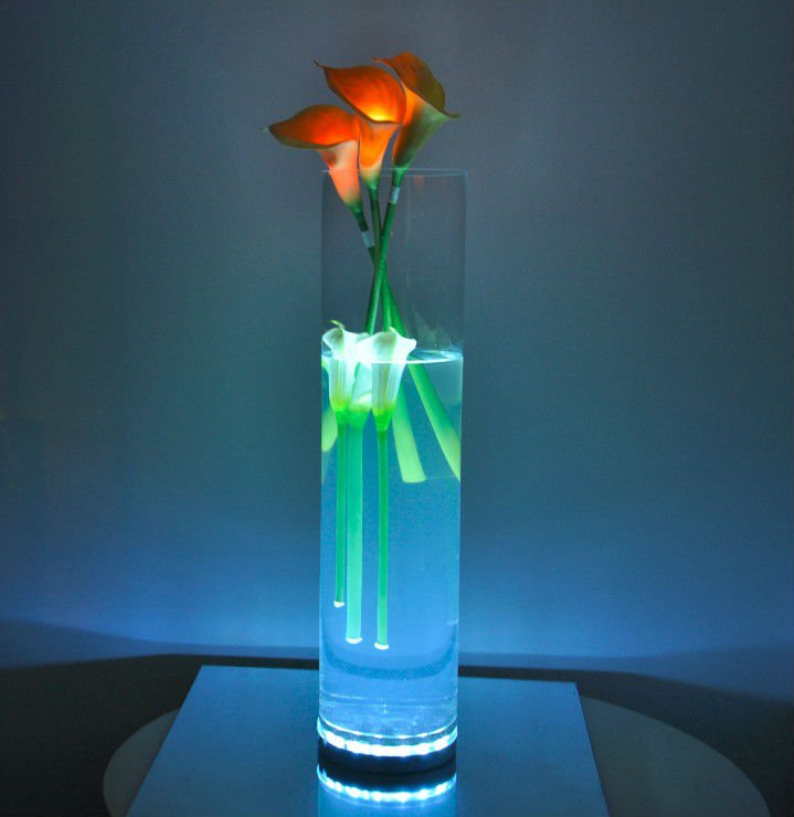 Centerpieces with led lights in vases