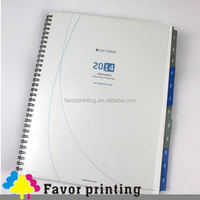 spiral notebook with colored index tab divider