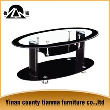 black tempered glass and metal nesting tables