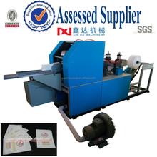 Automatic embossing printing folding kleenex napkin converting machine