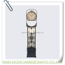 antique metal standing clock