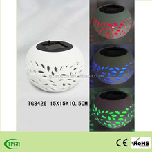 Ceramic lamp with solar LED light for garden and home decoration