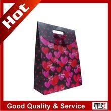 self-adhesive closure/ die-cut handle paper bags producer