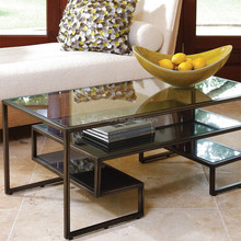 Rectangular coffee table with golden metal frame and toughened glass top