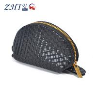 New design woven grain leather female korean cosmetic bag makeup case with golden zipper and unique shape