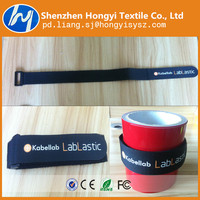 Customized adjustable hook and loop strap with plastic button