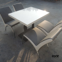 Modern design acrylic solid surface table for hotel popular stone table