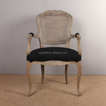 Rattan back dining chair with arm