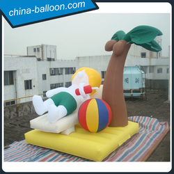 Customized inflatable beach boy characters/ lying shaped inflatable boy for beach decoration