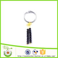 8.5cm natural brown color drum shape coconut shell bead wholesale bulk keyrings with custom logo