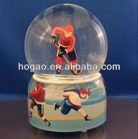ice hockey player snow globe