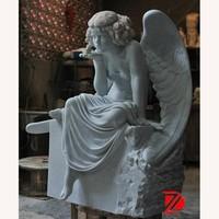 white stone angel girl statue speaking with bird