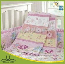 appliqued baby floral cot bumper set and quilt