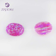 Flat cabochon oval cut pink synthetic opal