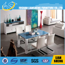 Beach sea feel white glass top dining table with stainless steel frame and solid wood legs with high glossy painting