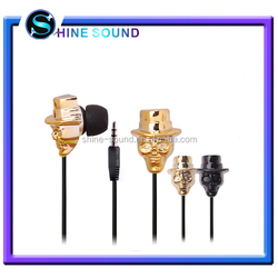 Mobile phone accessories factory in China skull earphone