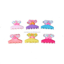 Merry christmas wolverine claw cheap wholesale children hair claw clip with butterfly design.