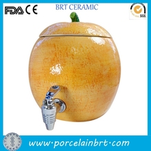 Ceramic orange cold beverage dispenser with tap