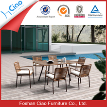 Glass dining table rattan arm chair set for 6 people
